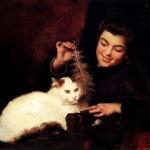 Девушка, играющая с котом
